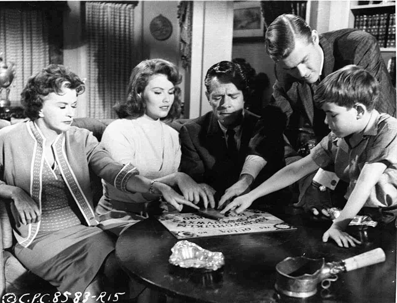 The family conduct a seance - (l to r) Rosemary DeCamp, Jo Morrow, Donald Woods, Martin Milner and Charles Herbert in 13 Ghosts (1960)