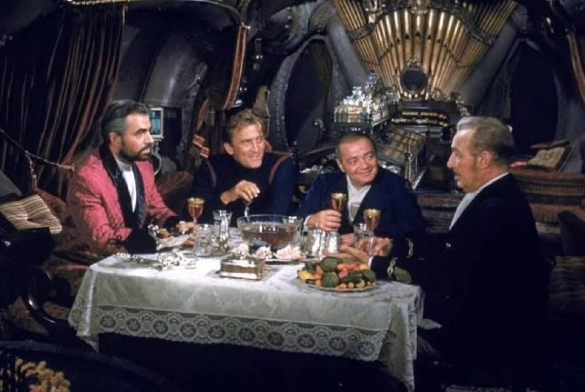 All aboard The Nautilus - (l to r) Captain Nemo (James Mason), Ned Land (Kirk Douglas), Conseil (Peter Lorre) and Professor Arronax (Paul Lukas) in 20,000 Leagues Under the Sea (1954)