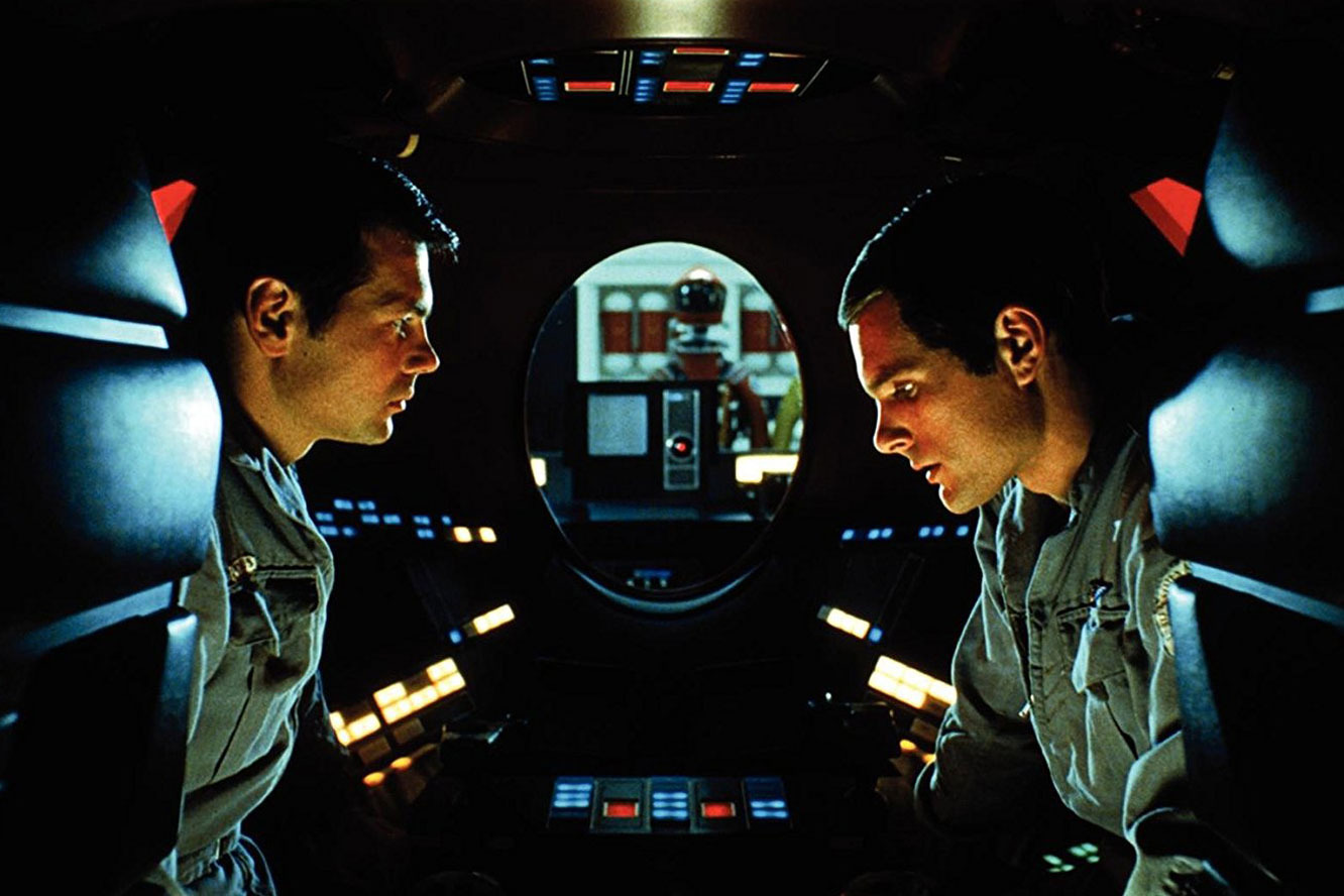 Gary Lockwood and Keir Dullea converse while HAL 9000 lip reads in 2001: A Space Odyssey (1968)