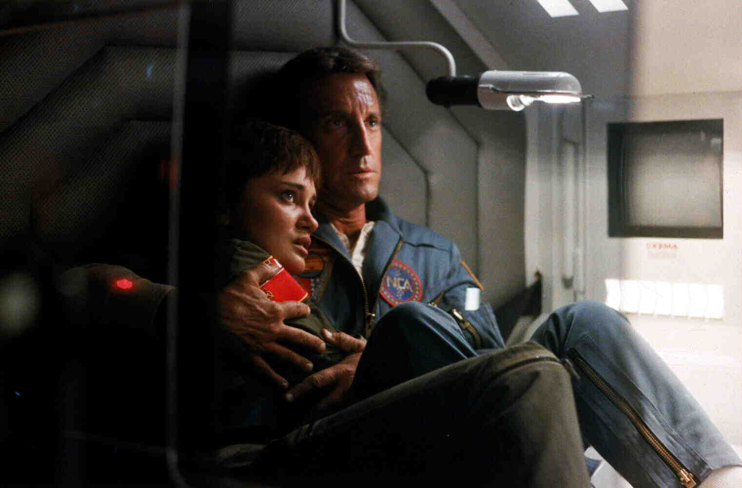 Dr Heywood Floyd (Roy Scheider) comforts cosmonaut Natasha Shneider during the slingshot in 2010 (1984)