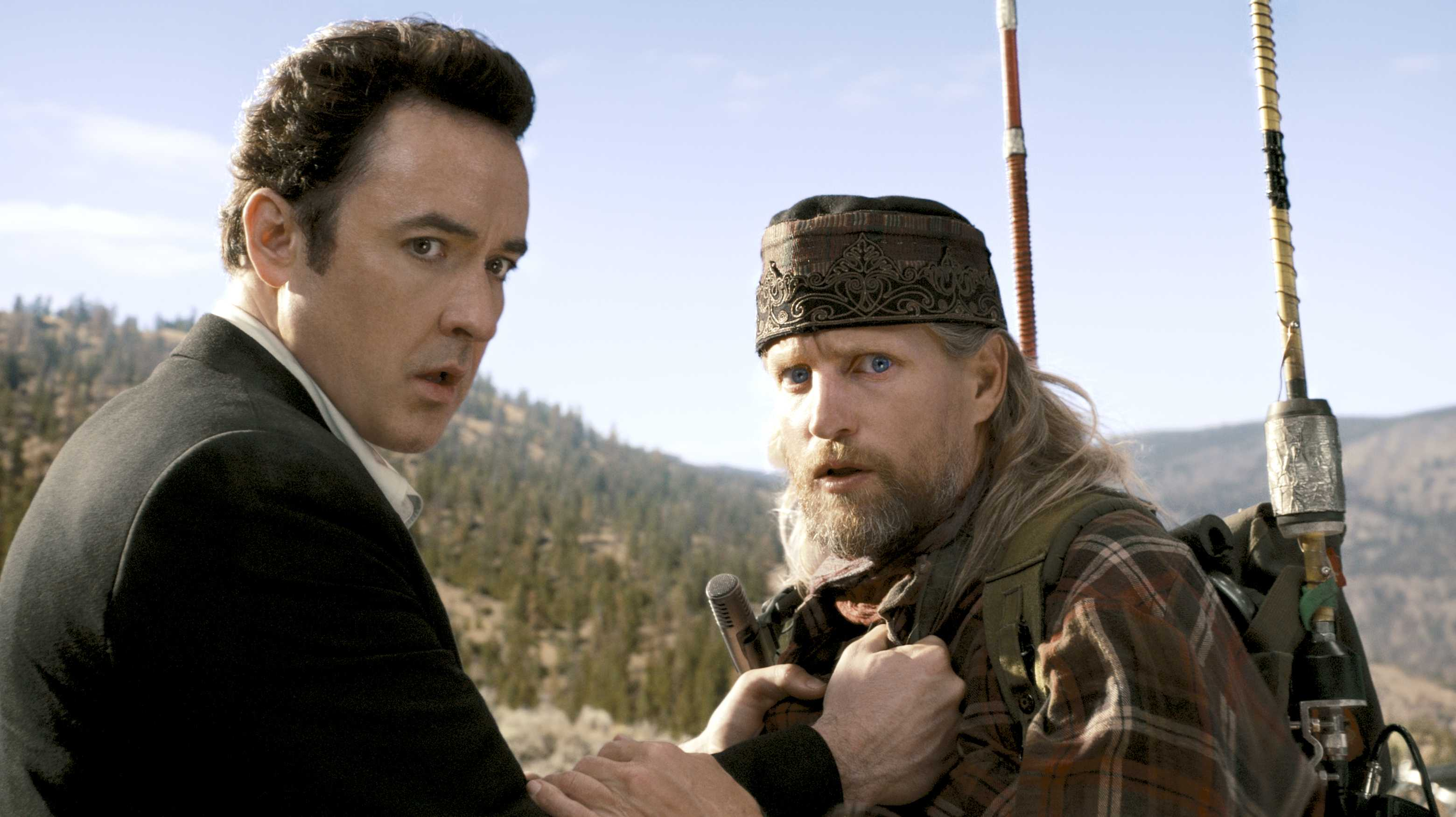 Science-fiction writer John Cusack and crackpot radio talkback host Woody Harrelson in 2012 (2009)