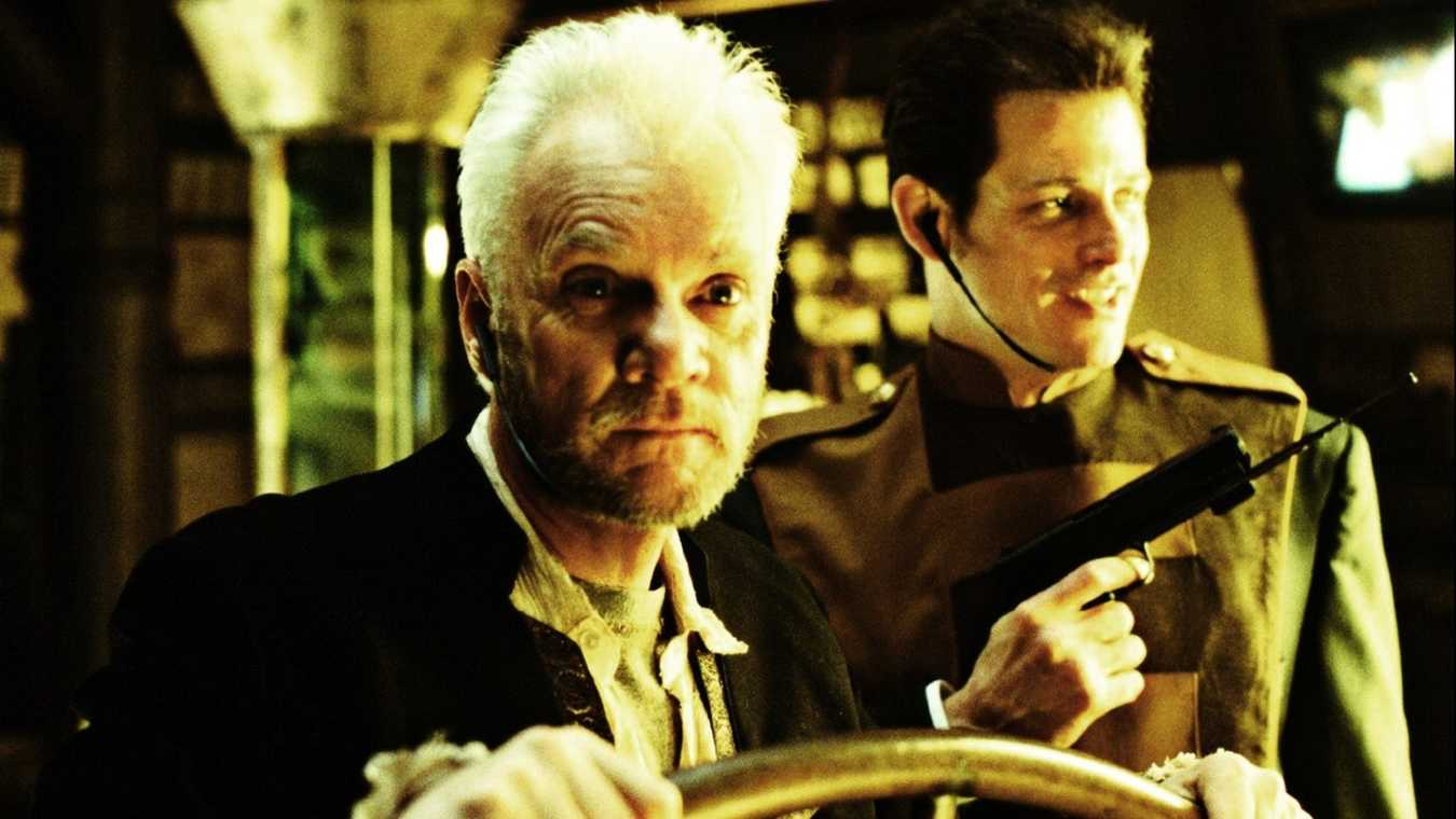 (l to r) Ship's captain Malcolm McDowell and security head Michael Paré in 2103: The Deadly Wake (1996)