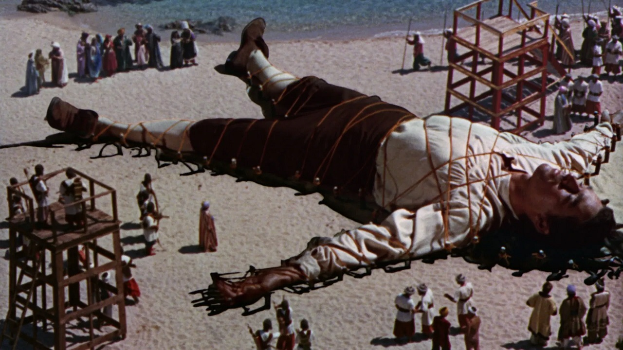 Lemuel Gulliver (Kerwin Mathews) imprisoned in the land of Lilliput in The 3 Worlds of Gulliver (1960)