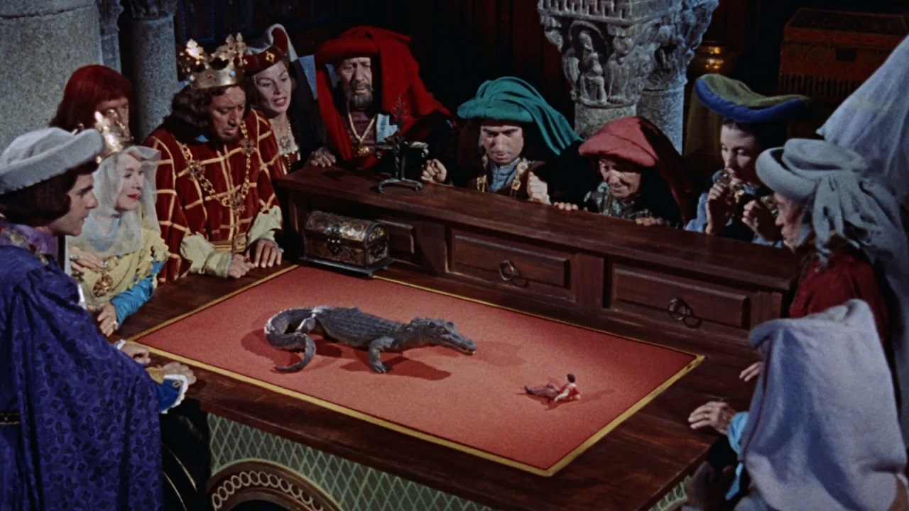 Gulliver (Kerwin Mathews) forced to fight a crocodile in Brobdingnag in The 3 Worlds of Gulliver (1960)