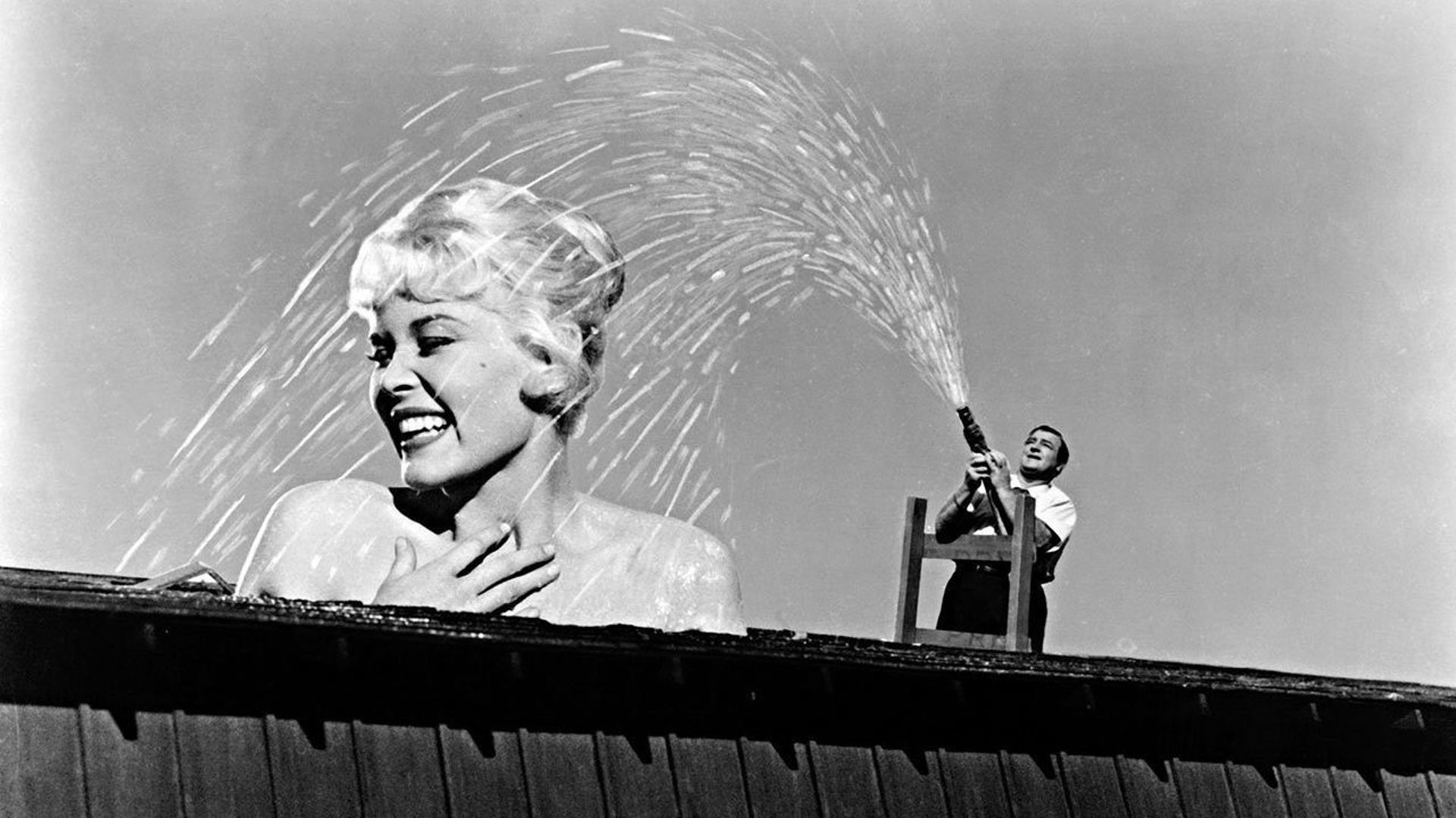 Lou Costello gives his giant-sized wife (Dorothy Provine) a shower in The 30 Foot Bride of Candy Rock (1959)
