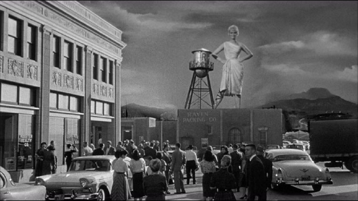 The thirty foot bride (Dorothy Provine) towers over the town in The 30 Foot Bride of Candy Rock (1959)