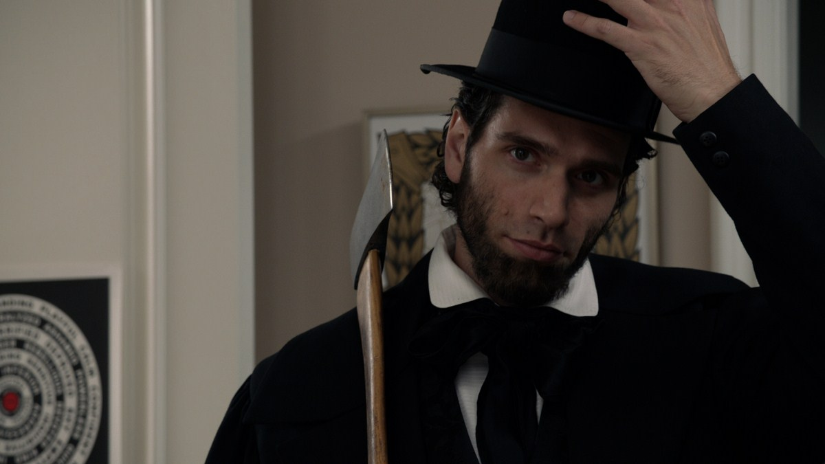 Ben Morrison as next-door neighbour Abe Lincoln in 30 Nights of Paranormal Activity with the Devil Inside the Girl with the Dragon Tattoo (2013)