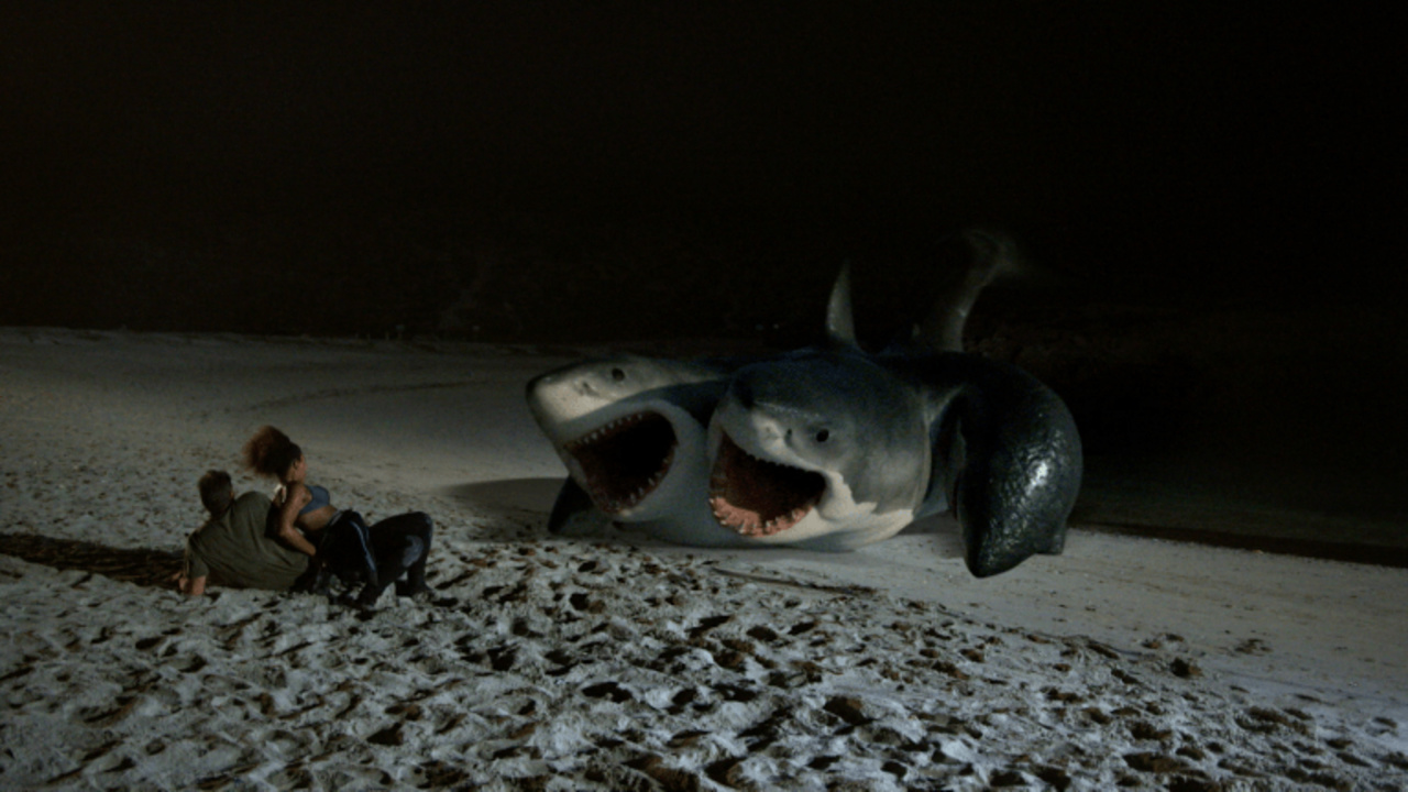 The six-headed shark emerges onto the beach to attack in 6-Headed Shark Attack (2018)