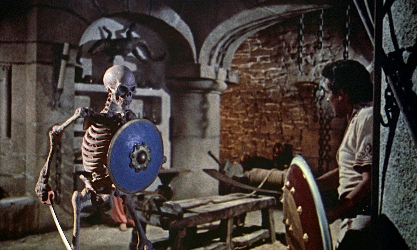 Sinbad (Kerwin Mathews) fights off the reanimated skeleton in The 7th Voyage of Sinbad (1958)