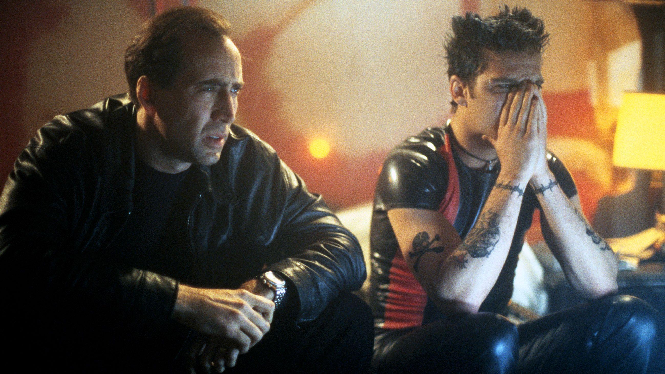 (l to r) Nicolas Cage and Joaquin Phoenix view a snuff movie in 8MM (1999)