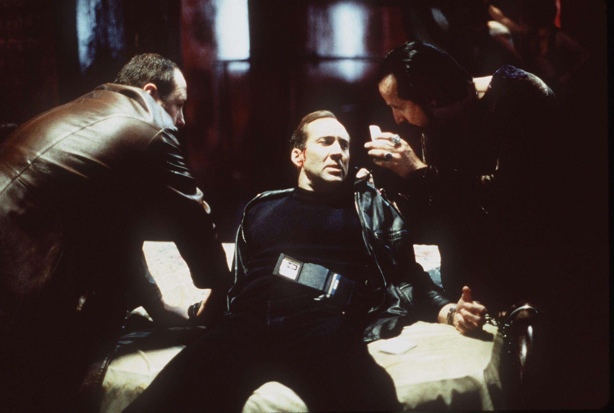 Nicolas Cage (c) is held down by James Gandolfini (l) and Peter Stormare (r) in 8MM (1999)