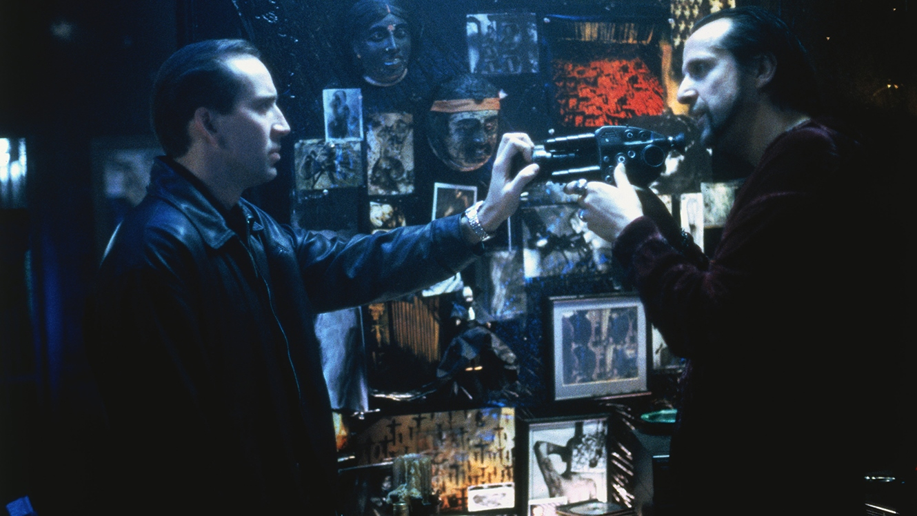 (l to r) Private detective Nicolas Cage confronts snuff movie maker Peter Stormare in 8MM (1999)