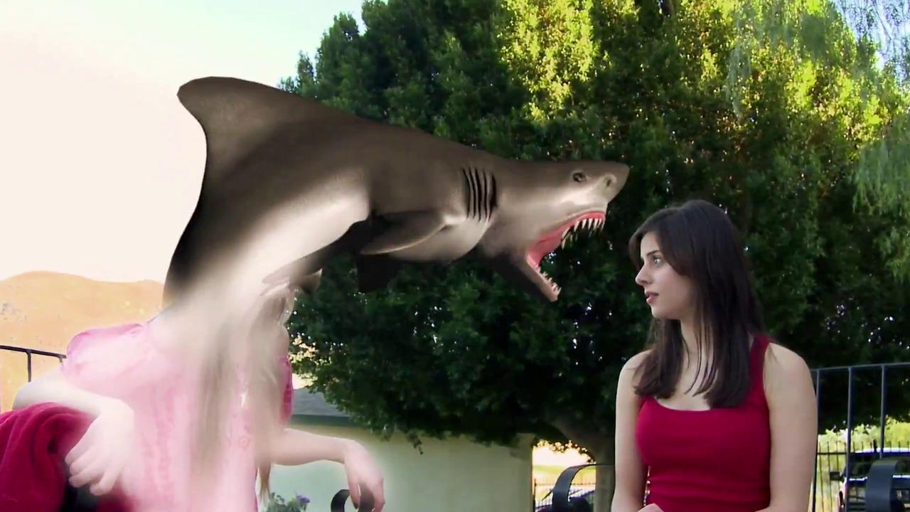 Rachel Rosenstein gets her head bitten off by a shark in 90210 Shark Attack (2014)