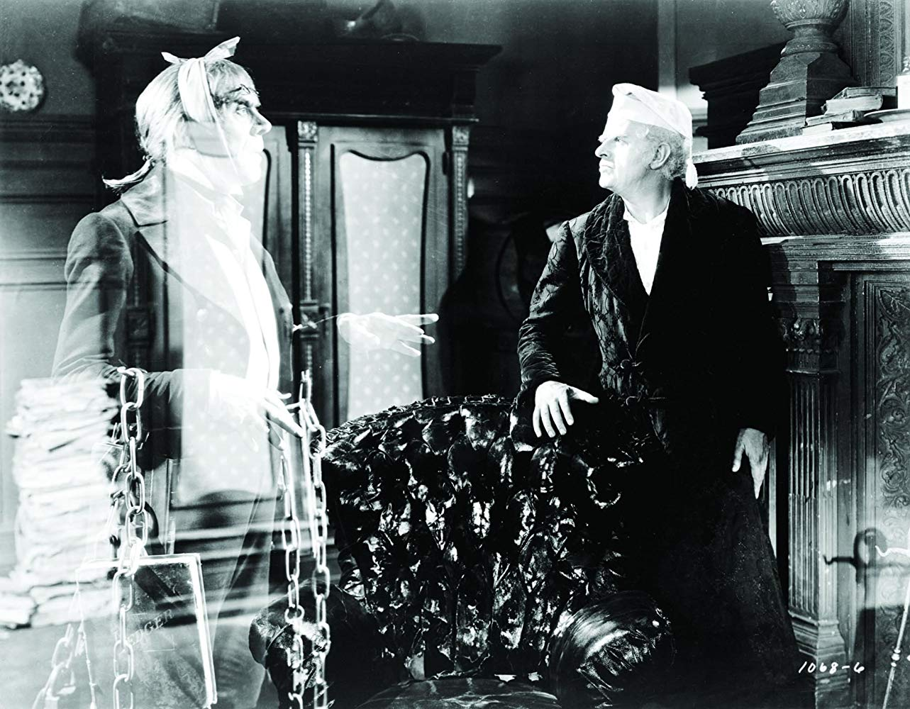 Scrooge (Reginald Owen) and the ghost of Jacob Marley (Leo G. Carroll) in A Christmas Carol (1938)