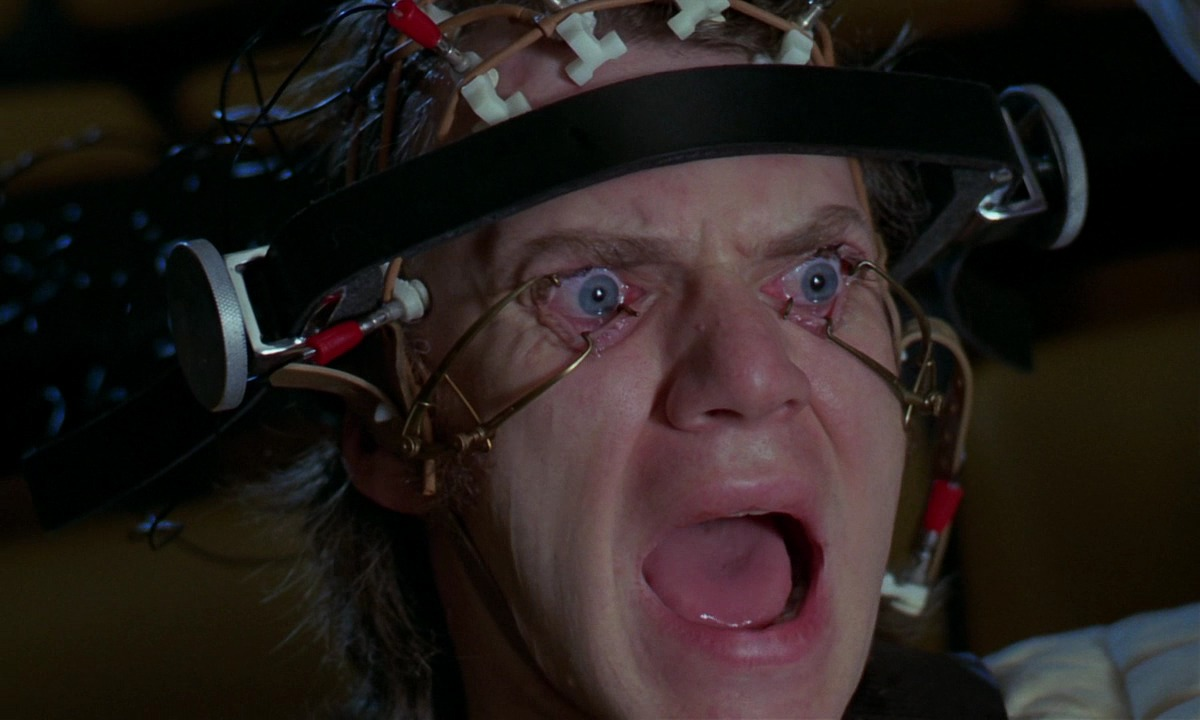 Alex (Malcolm McDowell) undergoes the Ludovico Treatment in A Clockwork Orange (1971)