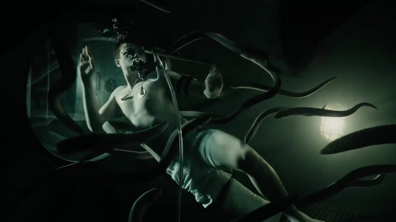 Dane DeHaan is placed inside a tank of eels in A Cure for Wellness (2016)
