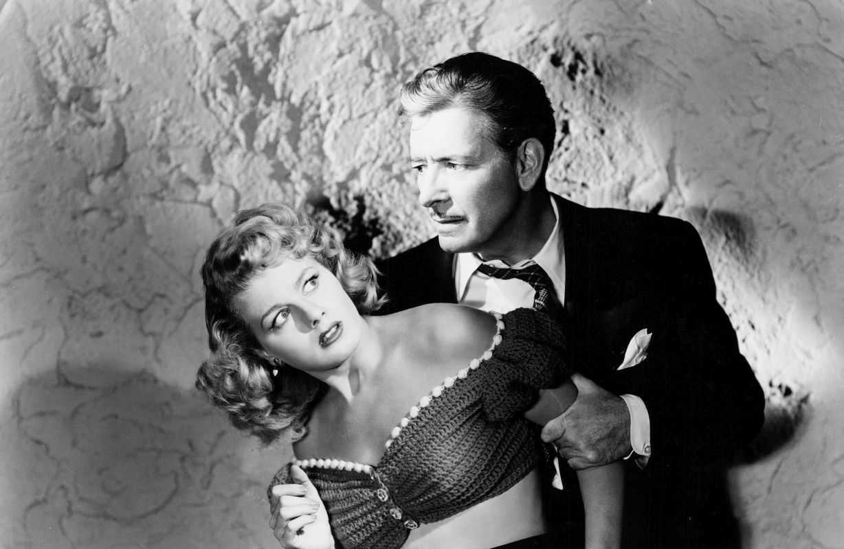Ronald Colman as an unbalanced Shakespearean actor with his leading lady Signe Hasso in A Double Life (1947)