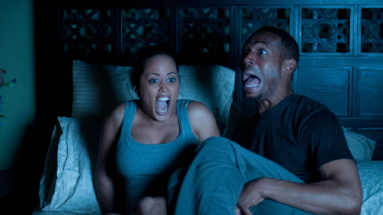 Marlon Wayans and wife Essence Atkins find they are haunted by a paranormal entity in A Haunted House (2013)