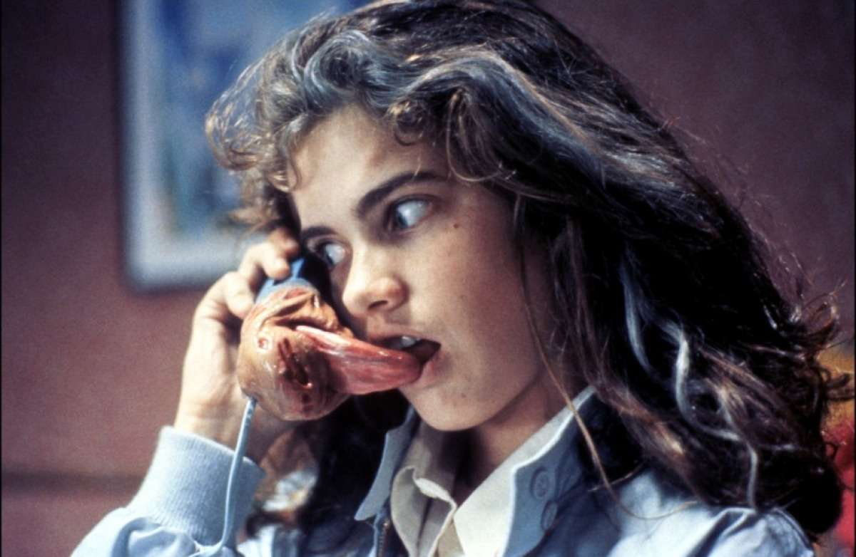 Nancy (Heather Langenkamp) answers the phone in A Nightmare on Elm Street (1984)