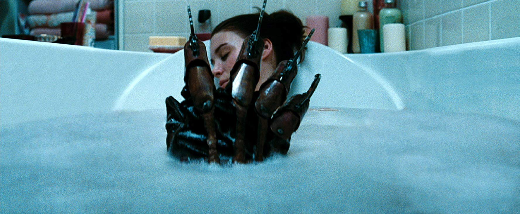 Freddy's claw appears in the bath as Nancy (Rooney Mara) sleeps in A Nightmare on Elm Street (2010)