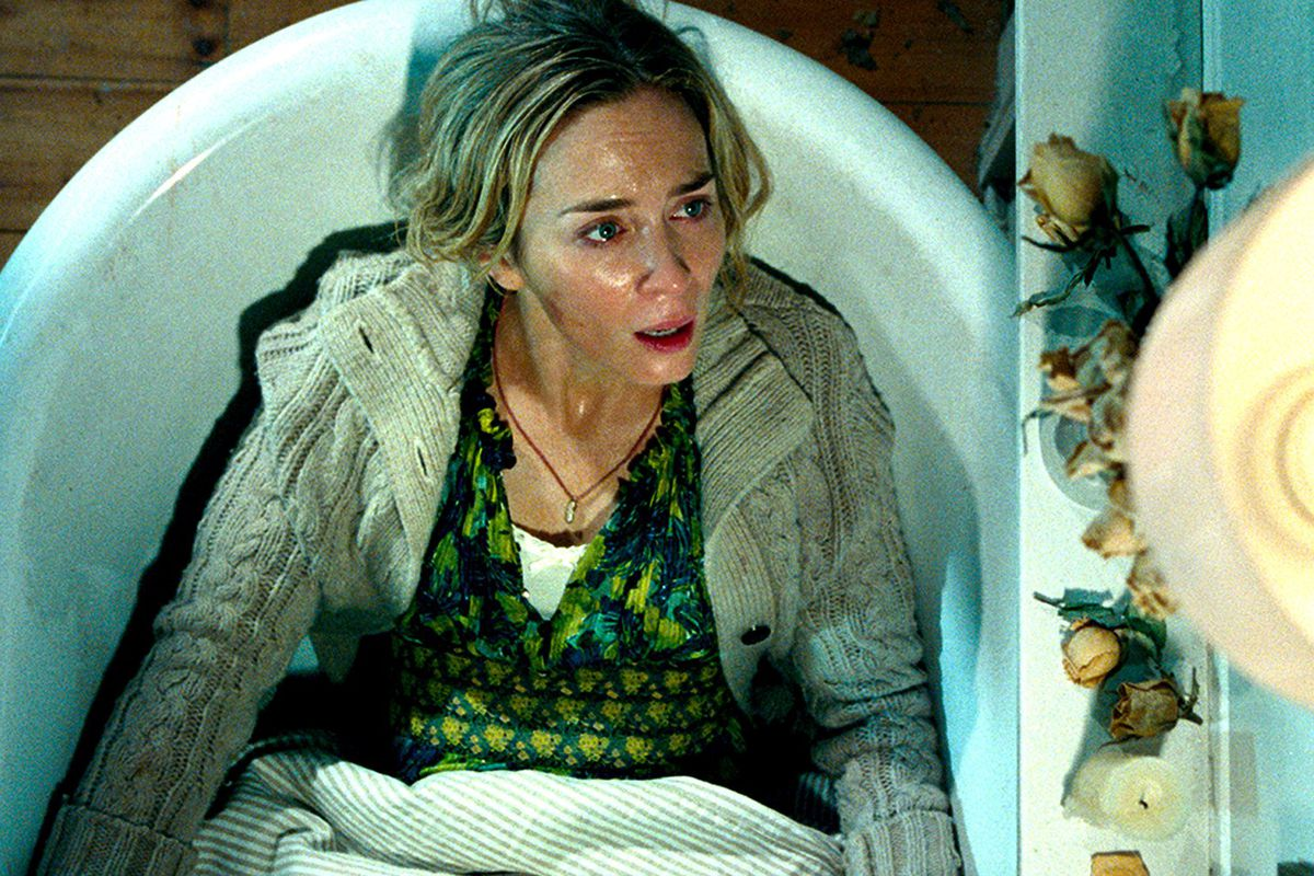 Emily Blunt gives birth in the bath in A Quiet Place (2018)