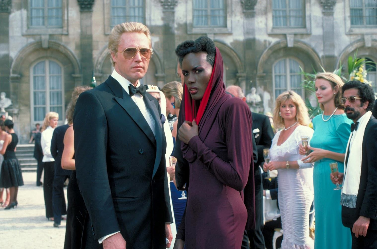 Christopher Walken as tech billionnaire villain Max Zorin with Grace Jones as henchwoman May Day in A View to a Kill (1985)