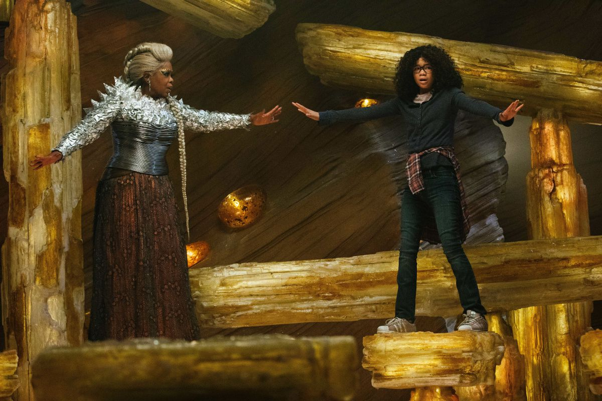 (l to r) Oprah Winfrey and Storm Reid - the art of standing on rocks on one leg and thinking happy thoughts in A Wrinkle in Time (2018)
