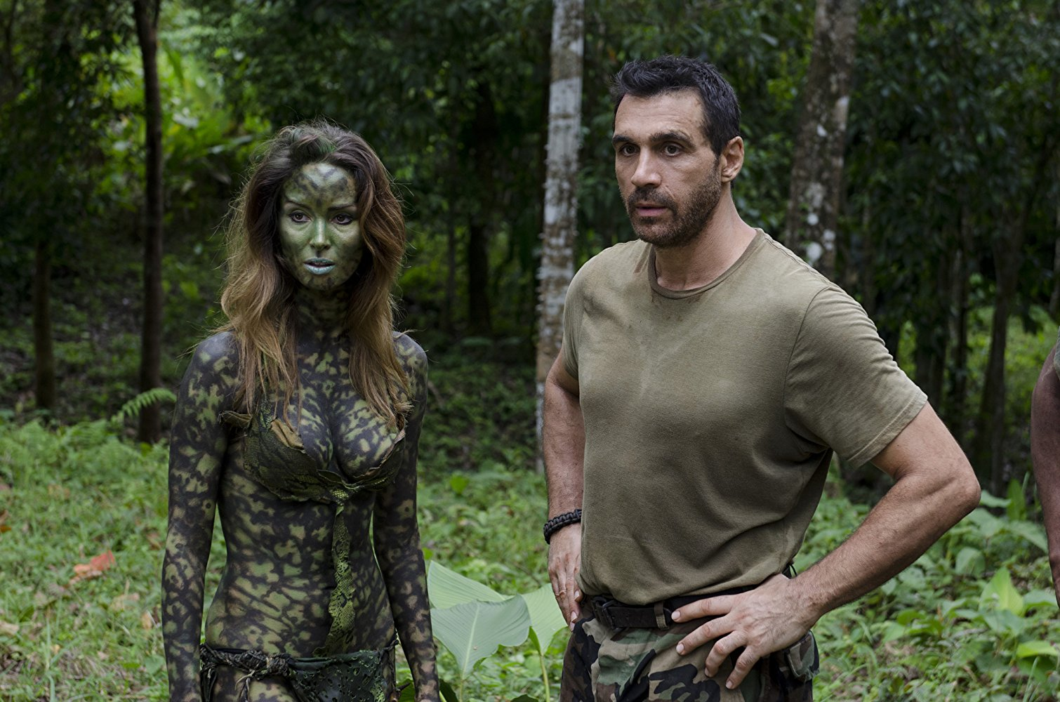 Lieutenant Frank Baum (Adrian Paul) and his alien love interest Lea (Bali Rodriguez) in AE: Apocalypse Earth (2013)