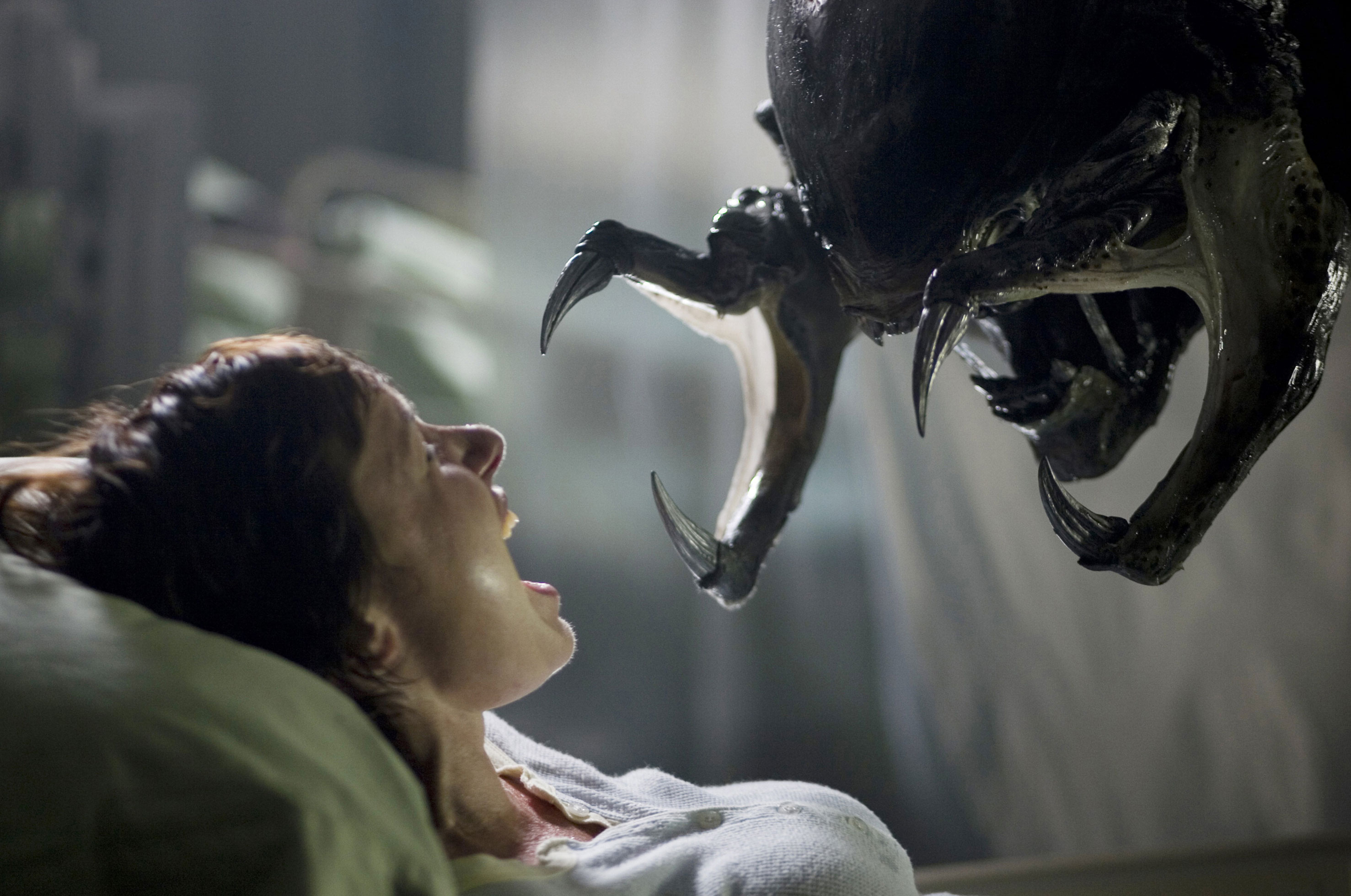 The alien goes to impregnate a pregnant woman (Victoria Bidewell) in AVPR Aliens vs Predator Requiem (2007)