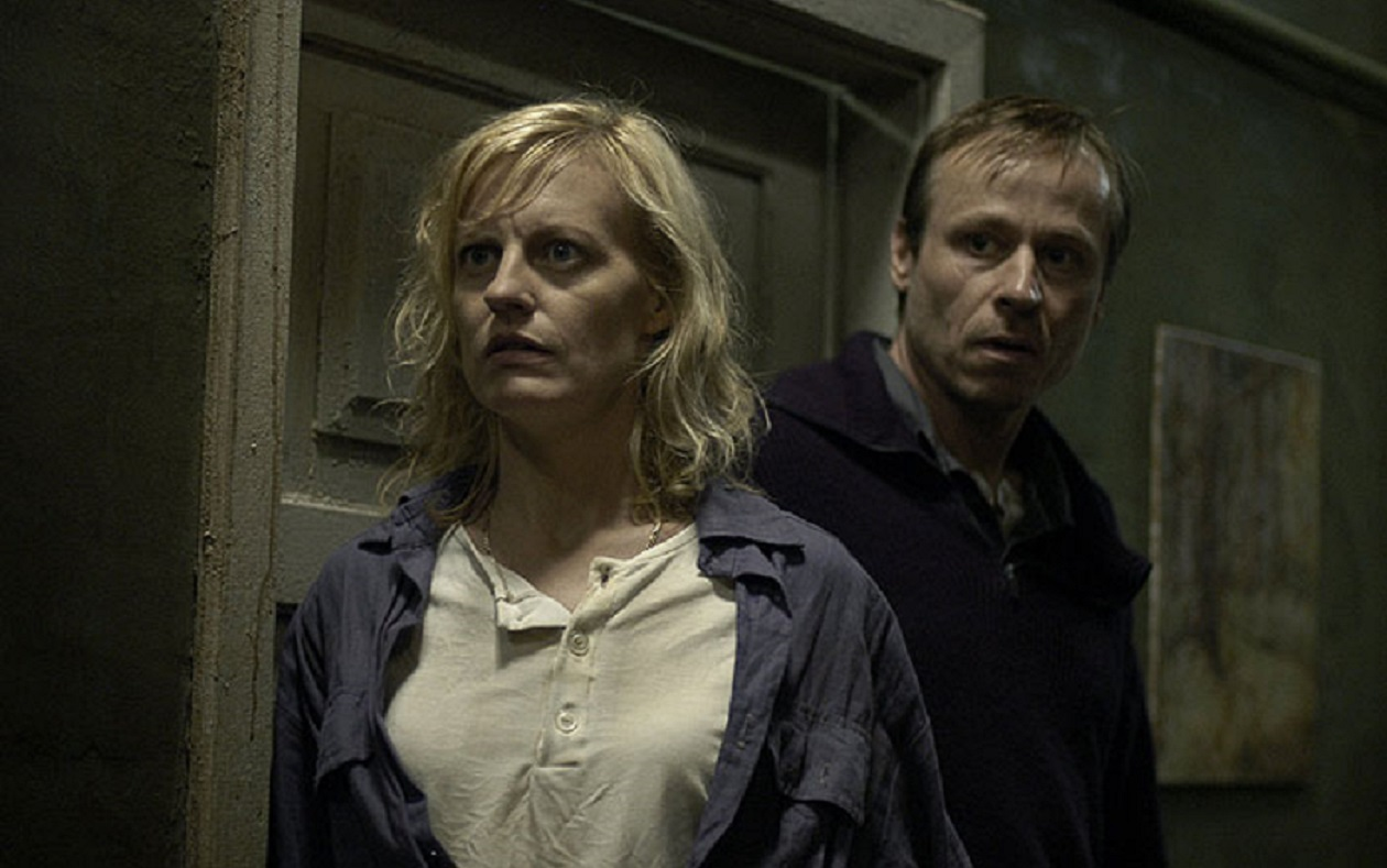 Brother and sister Anastasia Hille and Karel Rodin investigate the mysterious house in The Abandoned (2006)