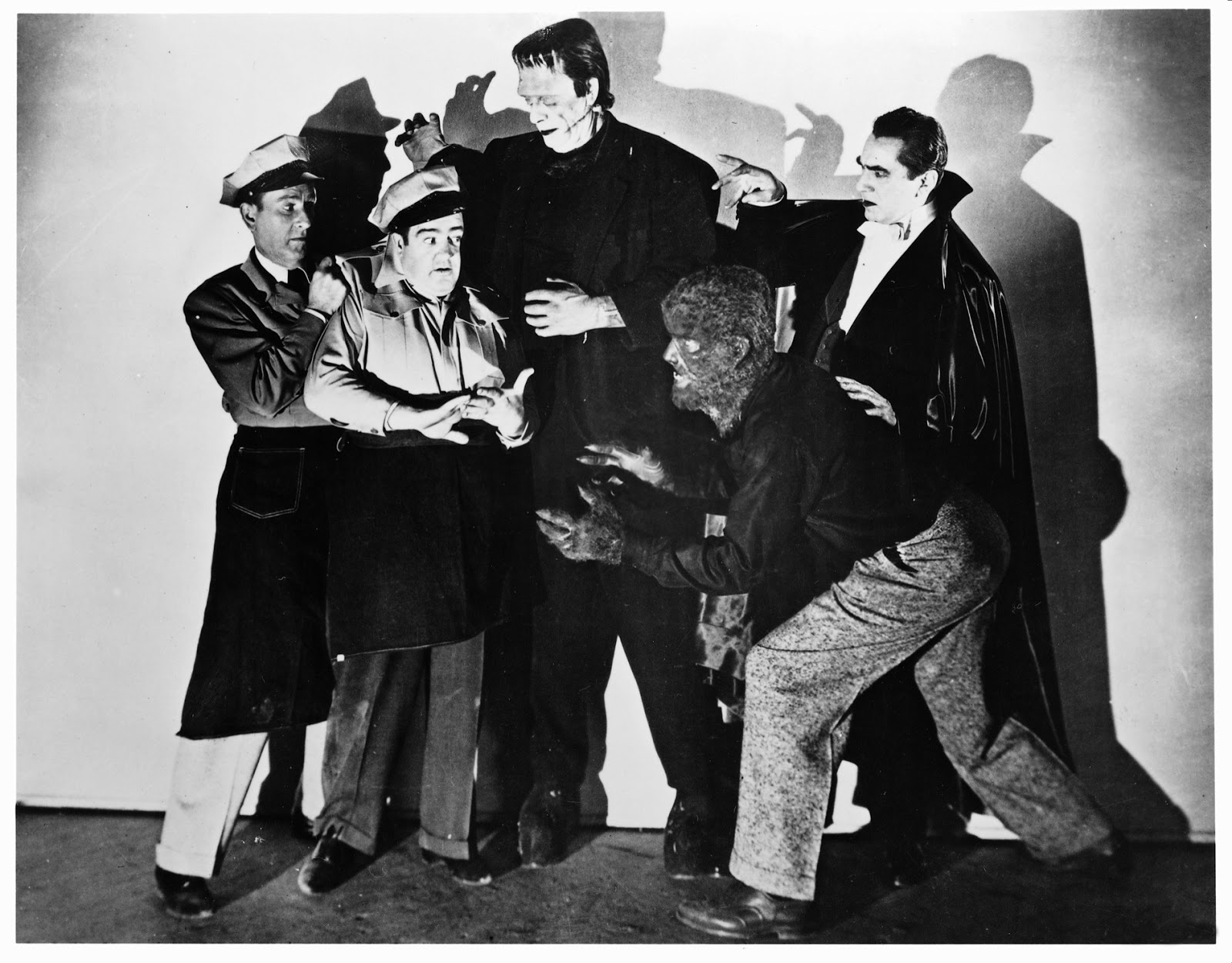 (l to r) Bud Abbott and Lou Costello meets the monsters - The Frankenstein Monster (Glenn Strange), Larry Talbot, The Wolf Man (Lon Chaney Jr) and Count Dracula (Bela Lugosi) in Abbott and Costello Meet Frankenstein (1948)