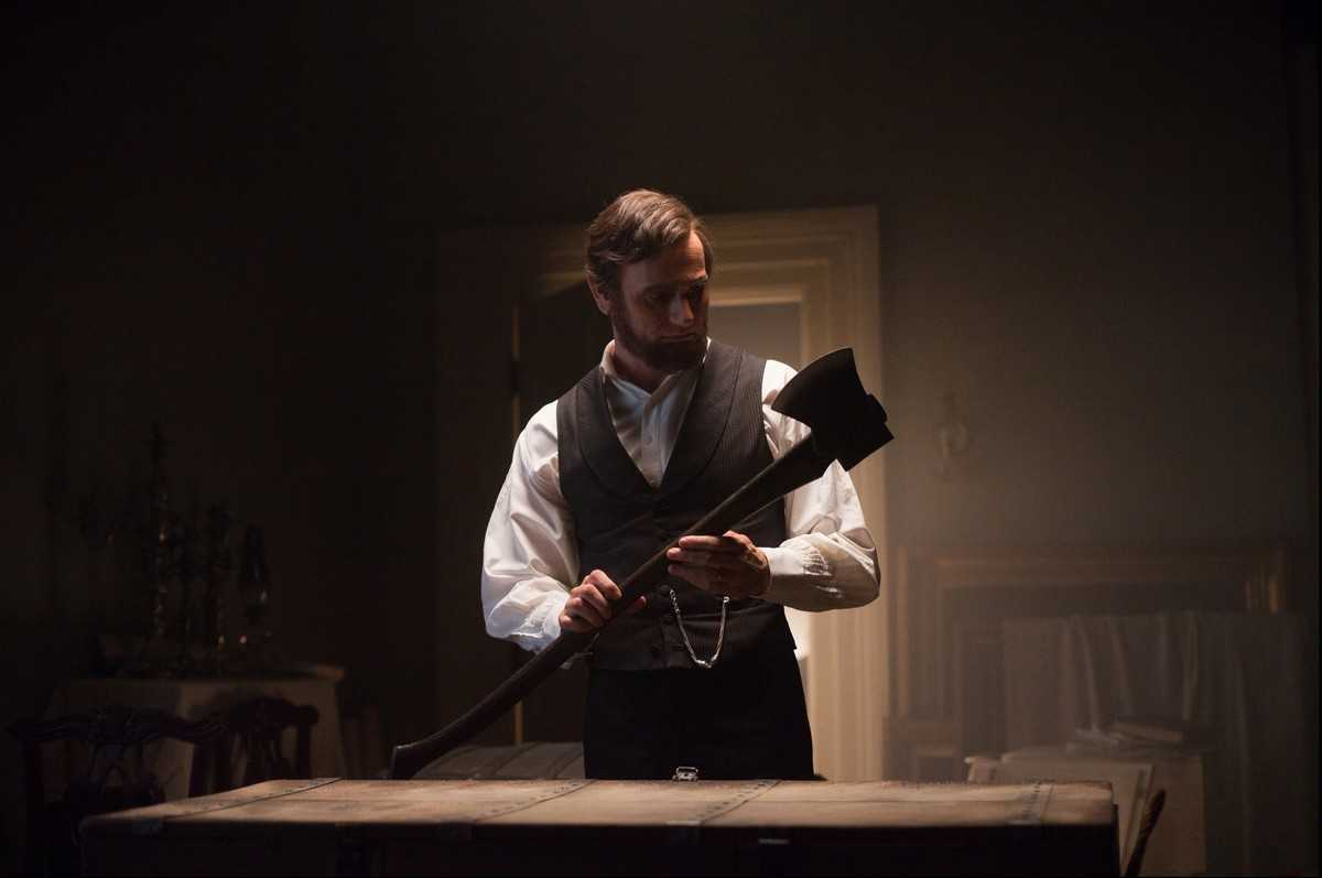 Abraham Lincoln (Benjamin Walker) prepares his axe for some vampire hunting in Abraham Lincoln, Vampire Hunter (2012)