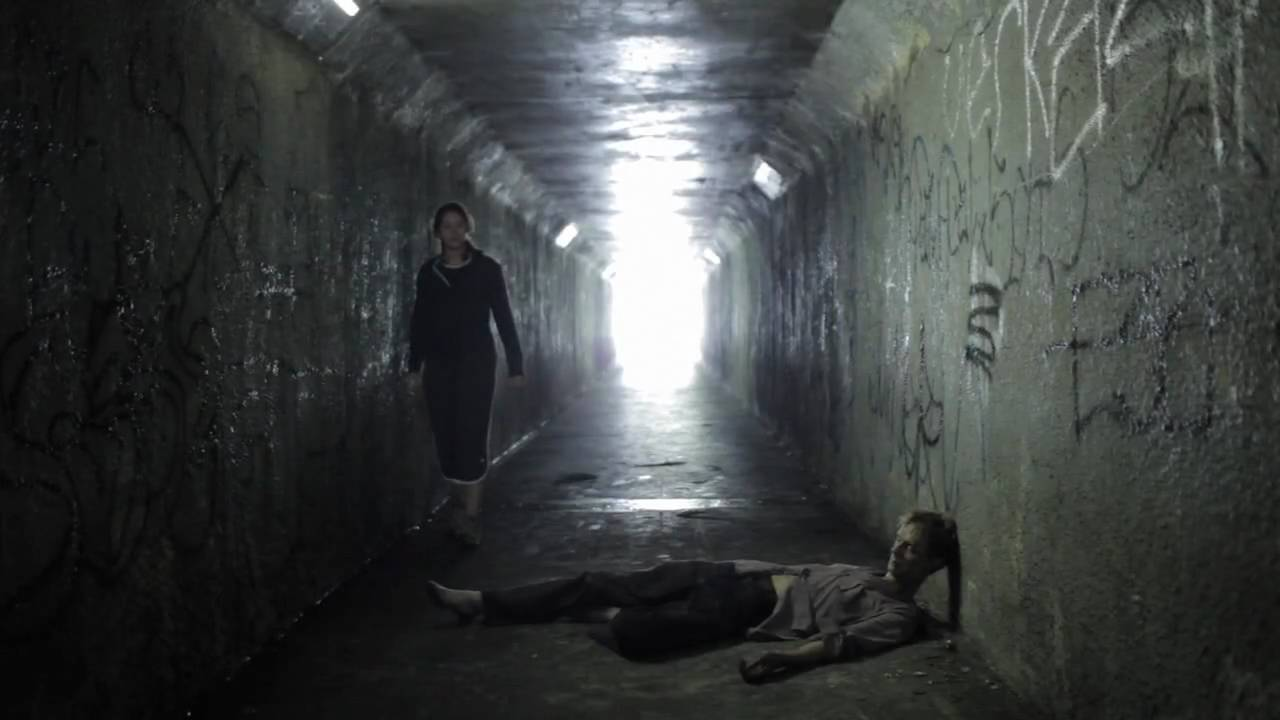 Katie Parker encounters Doug Jones in the walkway tunnel in Absentia (2011)
