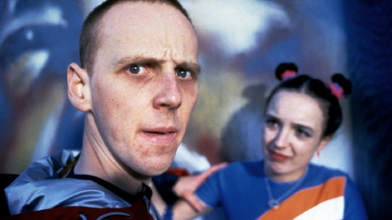 Ewen Bremner as the man who has swapped minds with a baby, and Arlene Cockburn in The Acid House (1998)