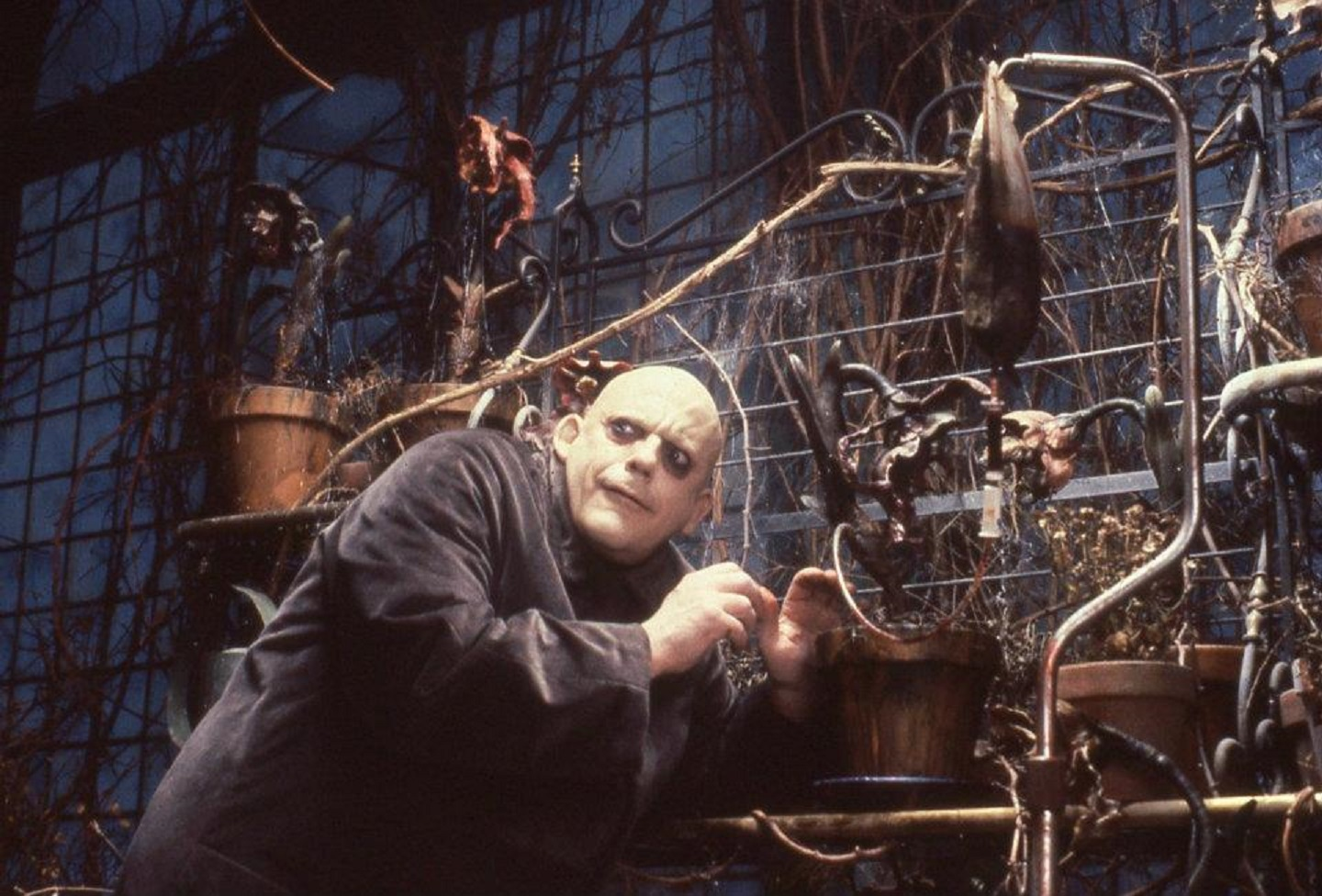 Uncle Fester (Christopher Lloyd) conducts mad science in The Addams Family (1991)