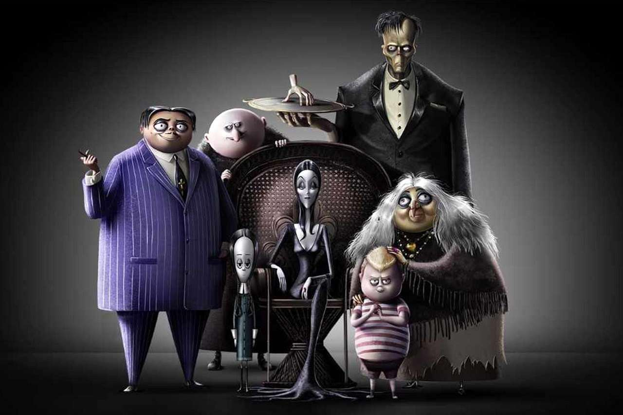 The animated Addams Family - (clockwise from left) (Gomez (voiced by Oscar Isaac), Uncle Fester (voiced by Nick Kroll), The Thing, Lurch, Grandma (voiced by Bette Midler), Pugsley (voiced by Finn Wolfhard), Morticia (voiced by Charlize Theron) and Wednesday (voiced by Chloe Grace Moretz) in The Addams Family (2019)