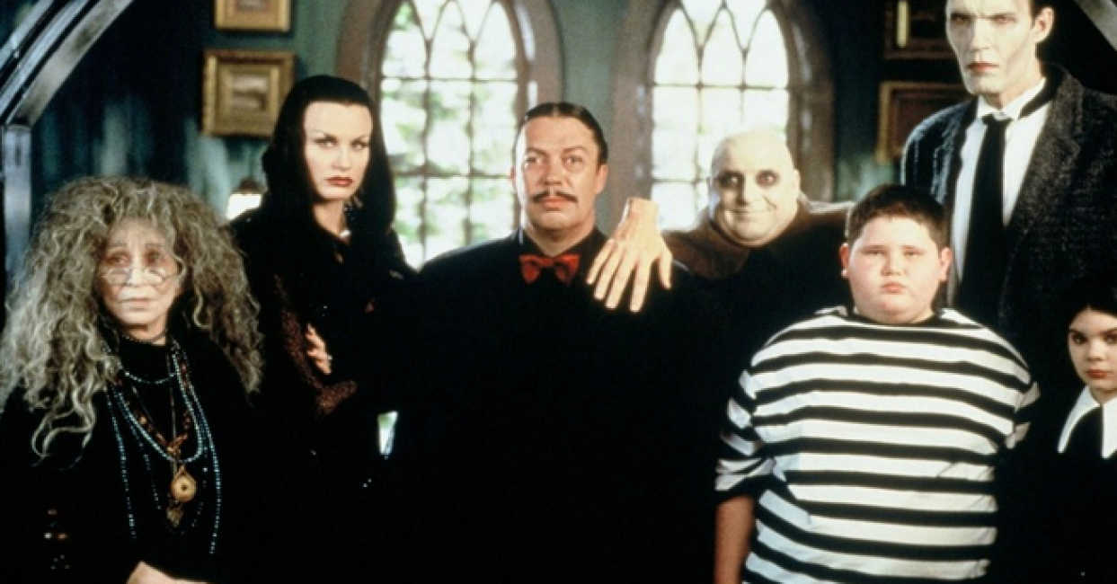 The Addams Family - (l to r) Granny (Alice Ghostley), Morticia (Darryl Hannah), Gomez (Tim Curry), Uncle Fester (Pat Thomas), Pugsley (Jerry Messing), Lurch (Carel Struycken) and Wednesday (Nicole Fugere) in Addams Family Reunion (1998)