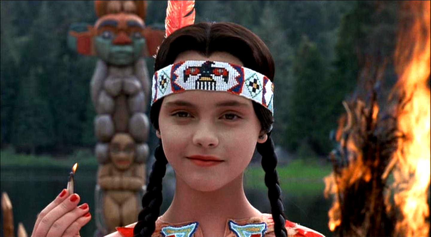 Wednesday (Christina Ricci) incites an uprising at summer camp as Pocahontas in Addams Family Values (1993)