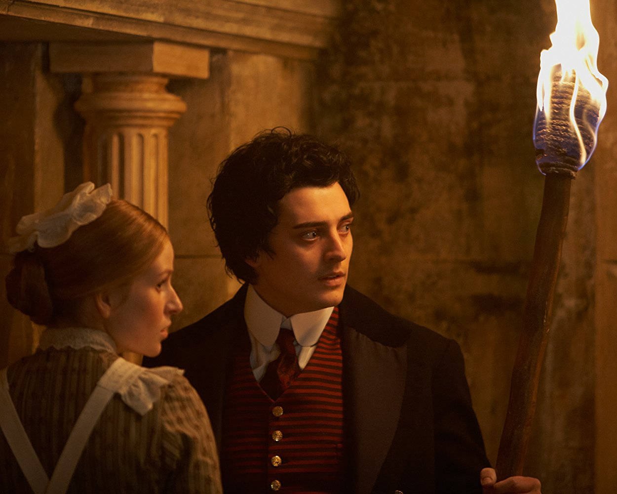 Mariah Mundi (Aneurin Barnard), along with the maid Sacha (Mella Carron), searches the secrets beneath the hotel in The Adventurer: The Curse of the Midas Box (2014)