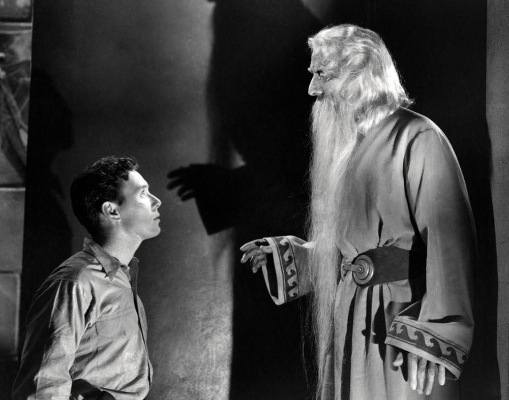 Billy Batson (Frank Coghlan Jr) is granted his powers by an ancient figure (Nigel De Brulier) in Adventures of Captain Marvel (1941)