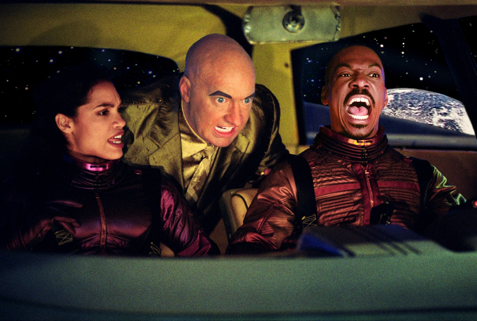 (l to r) Rosario Dawson, android Randy Quaid and Eddie Murphy on a Lunar journey in The Adventures of Pluto Nash (2002)