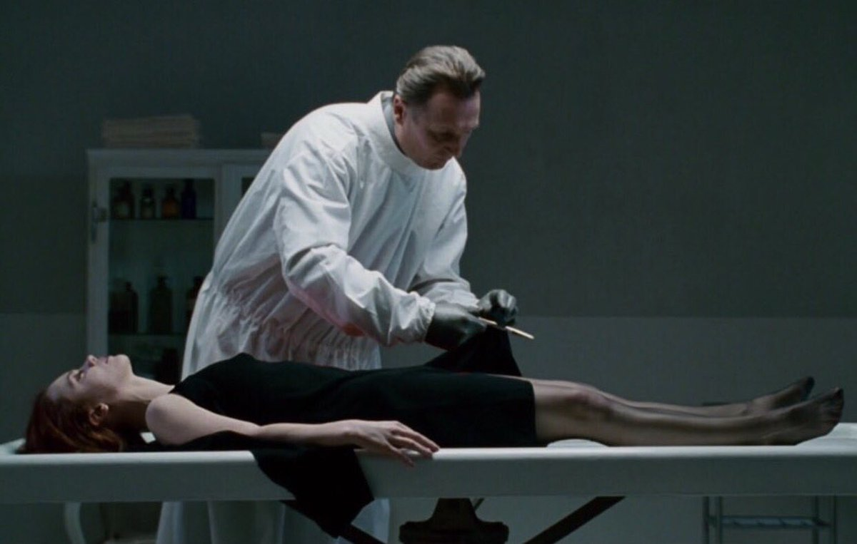 Liam Neeson dresses Christina ricci's body on the morgue table in After.Life (2009)