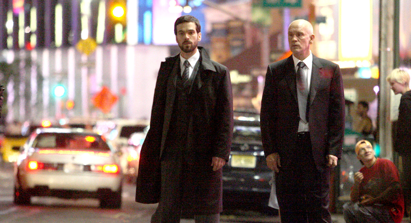 (l to r) Romain Duris and John Malkovich as the mysterious Messenger in Afterwards (2008)