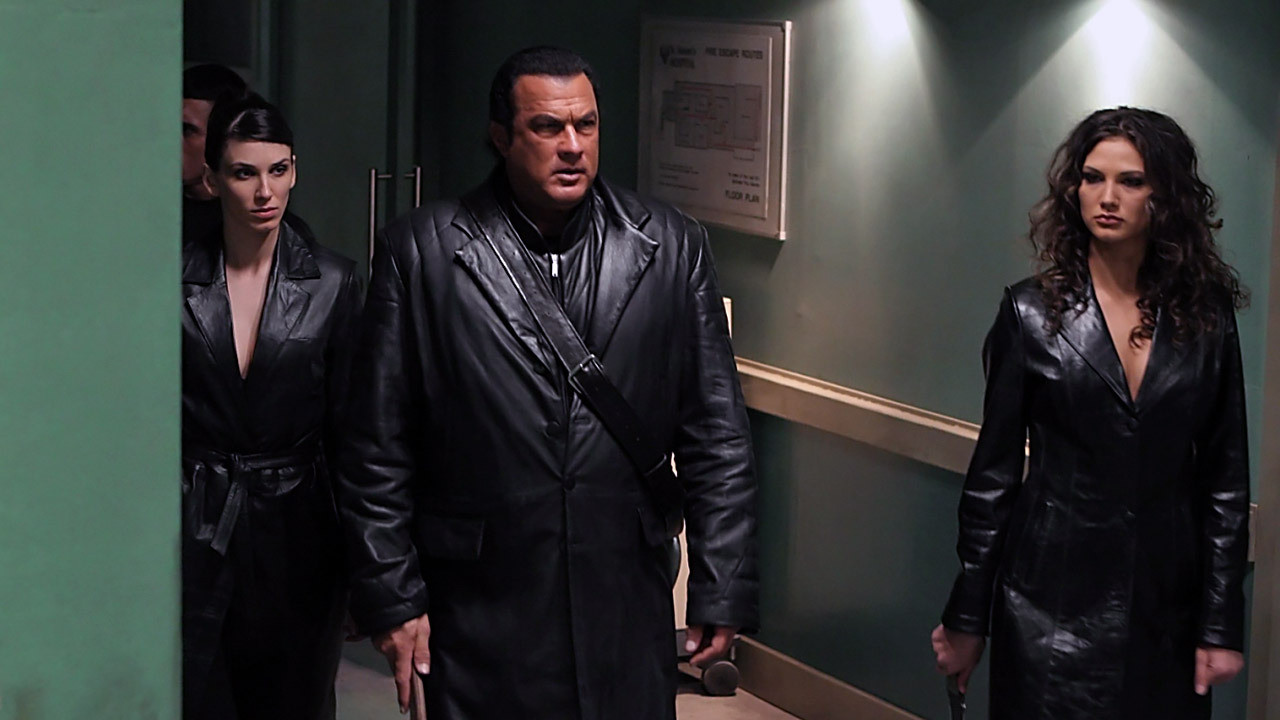 (l to r) Emma Catherwood, Steven Seagal and Andreea Ungureanu go hunting zombies in Against the Dark (2009)