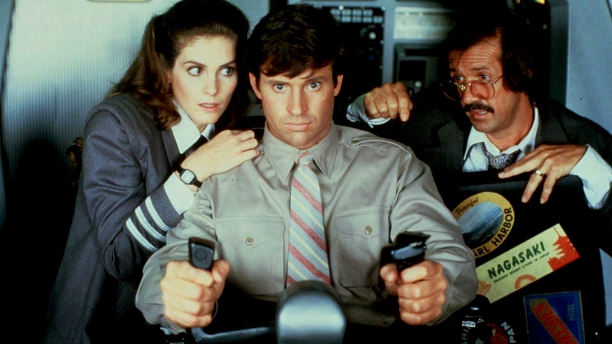 All aboard the shuttle - (l to r) air hostess Julie Hagerty and pilot Robert Hays returning from the first film, along with mad bomber Sonny Bono in Airplane II: The Sequel (1982)