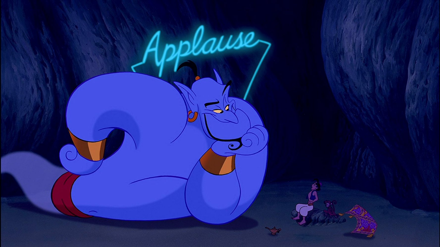 Much of the show overrun by a manically wisecracking Robin Williams as the Genie (l). With Aladdin (voiced by Scott Weinger) and Abu the monkey (bottom right) in Aladdin (1992)