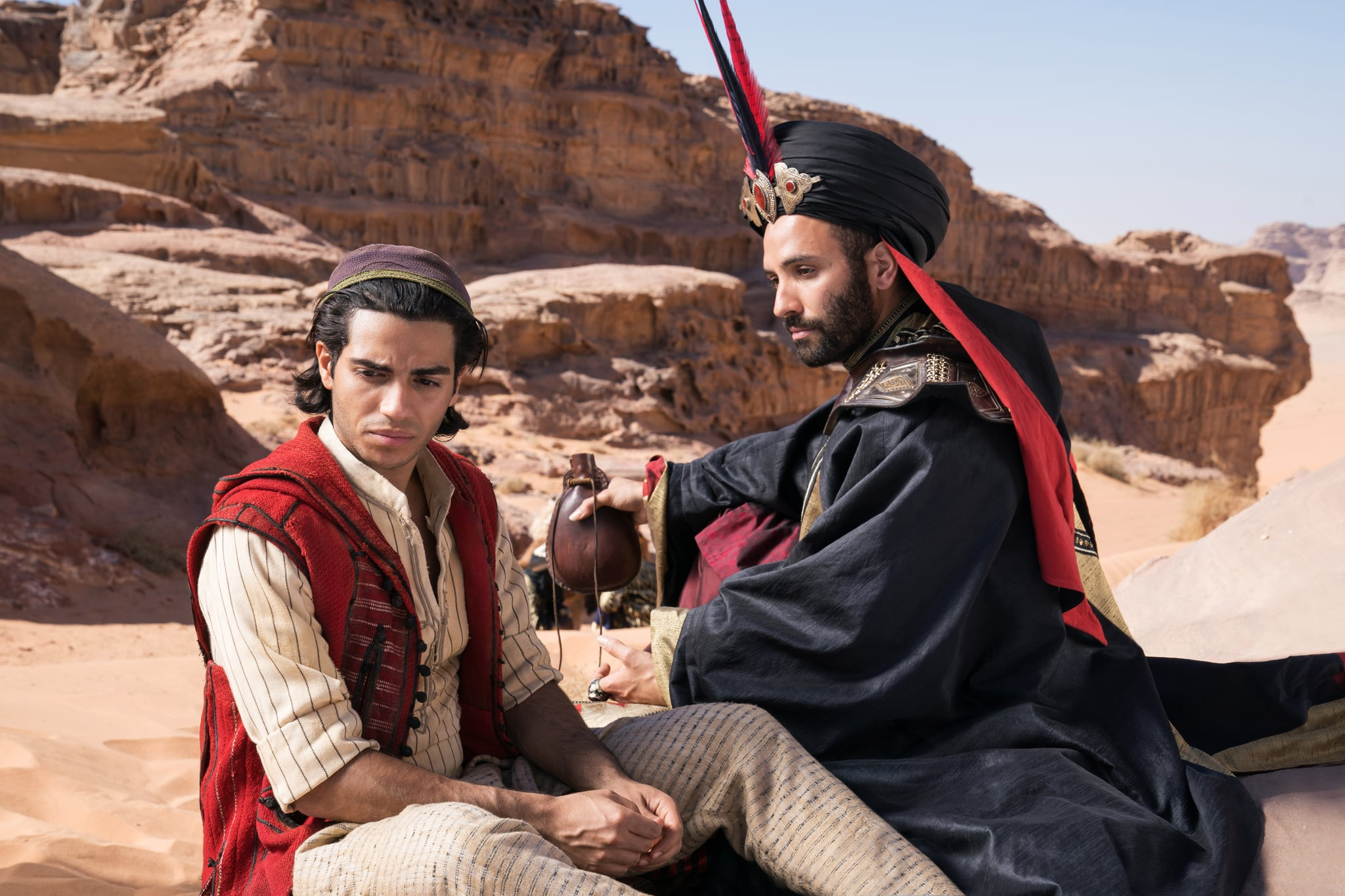 (l to r) Aladdin (Mena Massoud) is offered a deal by the vizier Jafar (Marwan Kenzari) in Aladdin (2019)