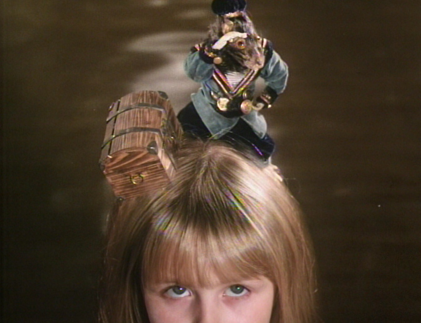 The dormouse sets up camp on Alice (Kristyna Kohoutova)'s head in Alice (1988)