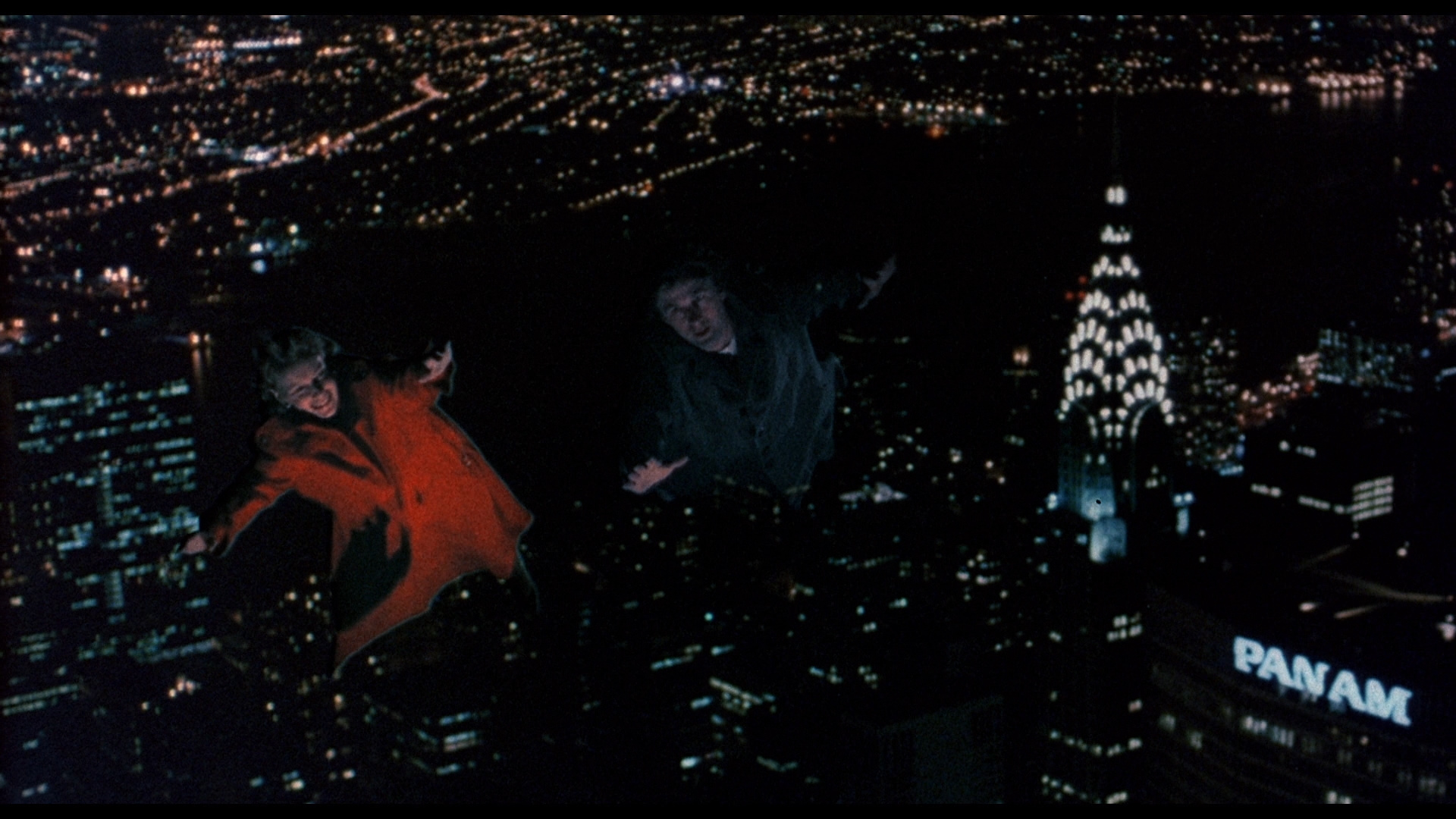 Alice (Mia Farrow) is taken on a flight through the night skies of Manhattan by a ghostly Alec Baldwin in Alice (1990)