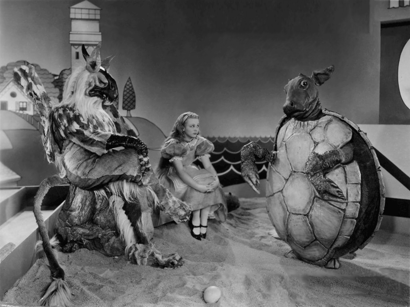 Alice (Charlotte Henry) with The Gryphon (William Austin) and The Mock Turtle (Cary Grant) in Alice in Wonderland (1933)